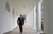US President Barack Obama walks through the Colonnade on his way to the Oval Office of the White House on January 28 2014 in Washington DC President...