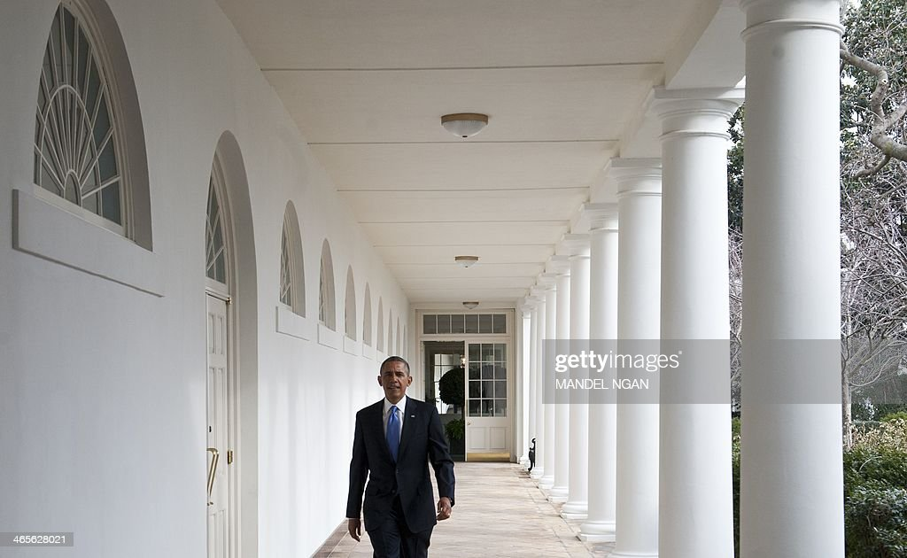 US President Barack Obama walks through the Colonnade on his way to the Oval Office of the White House on January 28, 2014 in Washington, DC. President Barack Obama will seek to rally confidence-sapped Americans and his own compromised political prospects Tuesday, in his showpiece annual State of the Union address. Obama will step up in the House of Representatives at 9pm (0200 GMT), wielding the issue of economic inequality as a cudgel against Republicans holding his second term hostage. AFP PHOTO/Mandel NGAN