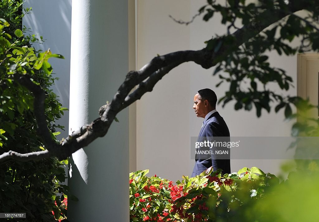 US President Barack Obama walks through the Colonnade to board Marine One on September 11, 2012 at the White House in Washington, DC. Obama is heading to the Walter Reed National Military Medical Center to visit wounded troops. AFP PHOTO/Mandel NGAN
