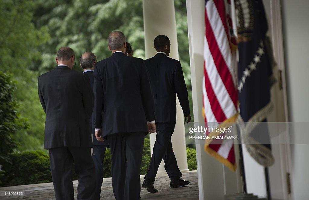 US President Barack Obama(R) walks through the colonnade to the Oval Office after speaking in the Rose Garden of the White House April 17, 2012 in Washington, DC. President Obama spoke about keeping oil prices low and enforcing fair pricing. AFP PHOTO/Brendan SMIALOWSKI