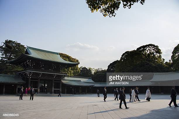 US President Barack Obama walks through the courtyard during a tour of the Meiji Shrine in Tokyo on April 24 2014 Obama earlier vowed to defend Japan...