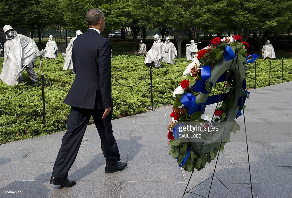 US President <a gi-track='captionPersonalityLinkClicked' href=/galleries/search?phrase=Barack+Obama&family=editorial&specificpeople=203260 ng-click='$event.stopPropagation()'>Barack Obama</a> walks through the Korean War Veterans Memorial after laying a wreath to commemorate the 60th anniversary of the signing of the Armistice that ended the Korean War, during a ceremony in Washington, DC, July 27, 2013. AFP PHOTO / Saul LOEB