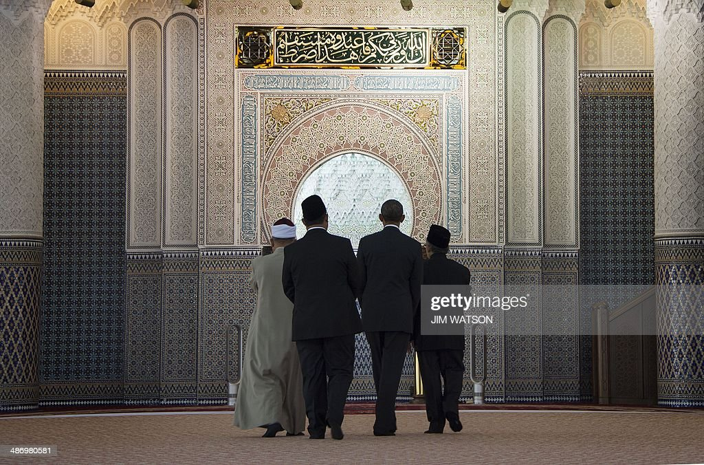 US President Barack Obama walks through the prayer room as he receives a tour from Grand Imam and Abdul Rashid Bin Md Isa of the National Mosque of...