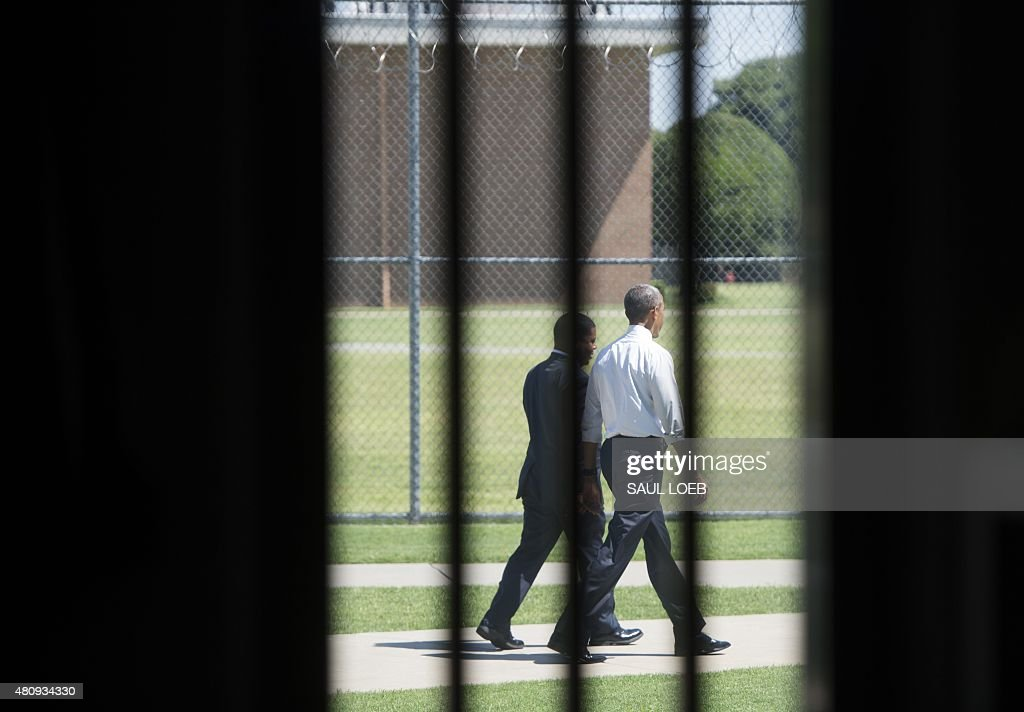 US President Barack Obama walks through the prison yard during a tour of the El Reno Federal Correctional Institution in El Reno Oklahoma July 16...