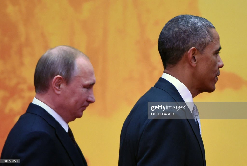 US President Barack Obama walks to a group photo session with Russian President Vladimir Putin at the AsiaPacific Economic Cooperation summit at...