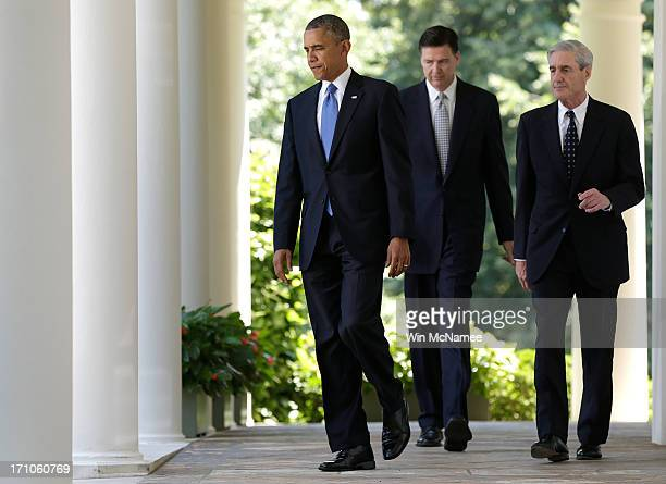 S President Barack Obama walks to a news conference to announce his nomination of James Comey to become FBI Director with outgoing director Robert...