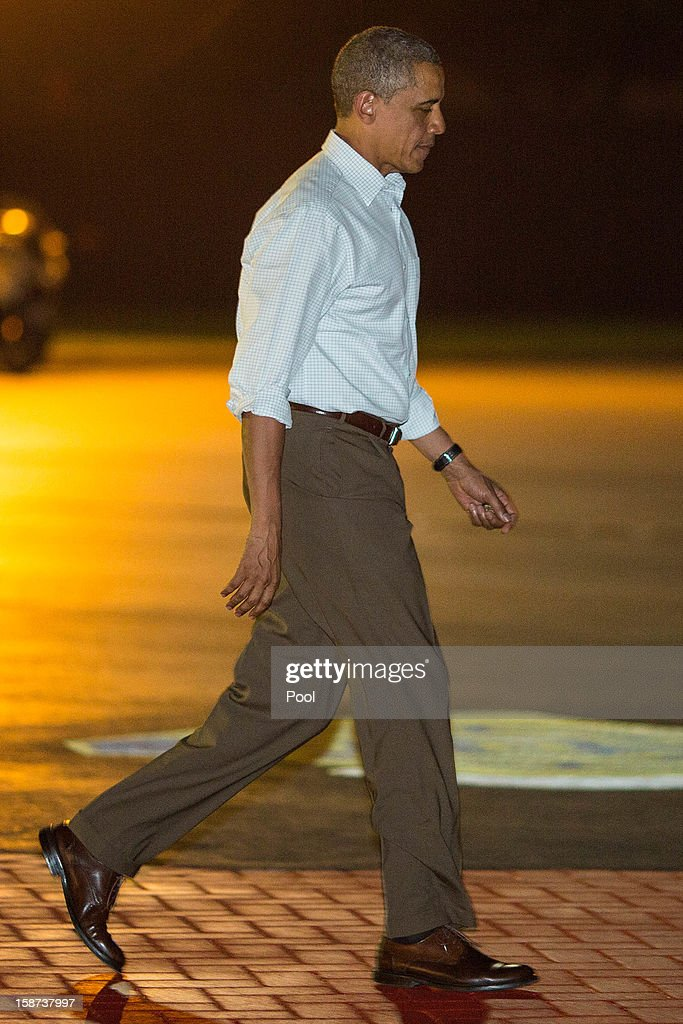 US President <a gi-track='captionPersonalityLinkClicked' href=/galleries/search?phrase=Barack+Obama&family=editorial&specificpeople=203260 ng-click='$event.stopPropagation()'>Barack Obama</a> walks to Air Force One at Joint Base Pearl Harbor-Hickam on December 26, 2012 in Honolulu, Hawaii. The president, who was spending a traditional Christmas holiday with his family in Hawaii, has been forced to cut his Christmas break short by the fiscal cliff crisis.