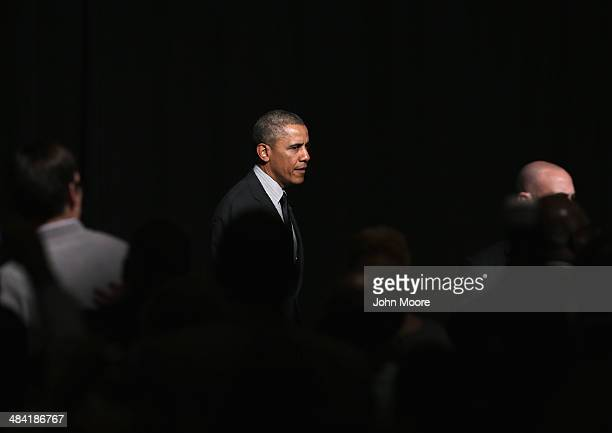 President Barack Obama walks to greet members of the National Action Network after speaking at their 16th annual convention at the Sheraton New York...
