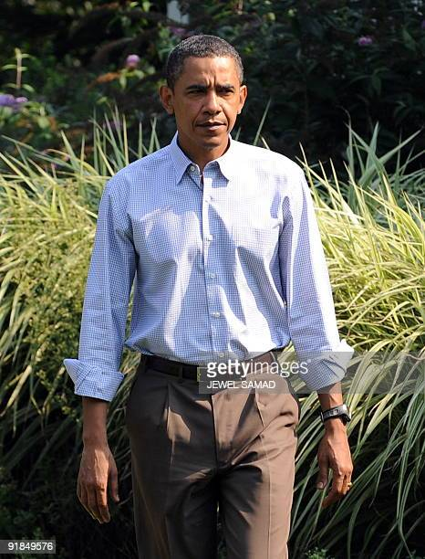 US President Barack Obama walks to make a statement over the death of US Senator Edward Kennedy at the Blue Heron Farm in Oak Bluffs on Martha's...