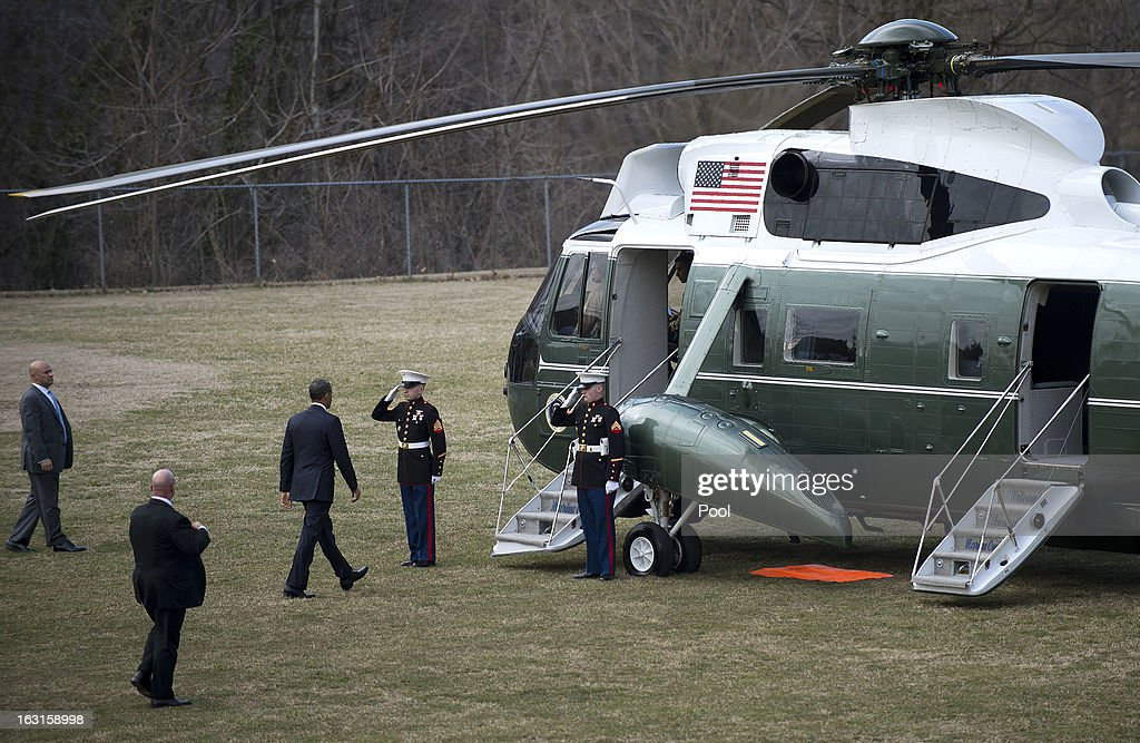 U.S. President <a gi-track='captionPersonalityLinkClicked' href=/galleries/search?phrase=Barack+Obama&family=editorial&specificpeople=203260 ng-click='$event.stopPropagation()'>Barack Obama</a> walks to Marine One after departing Walter Reed National Military Medical Center where he visited with wounded military personnel on March 5, 2013 in Bethesda, Maryland. Later today Obama and Vice President Biden will meet with newly instated Defense Secretary Chuck Hagel in the Oval Office.