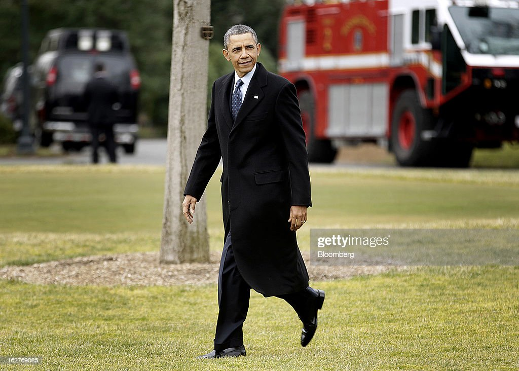 U.S. President Barack Obama walks to Marine One before departing from the White House in Washington, D.C., U.S., on Tuesday, Feb. 26, 2013. With just three days before the $85 billion in reductions for this year are scheduled to start, Obama and Republicans led by House Speaker John Boehner yesterday traded blame again for the impasse. Photographer: Joshua Roberts/Bloomberg via Getty Images