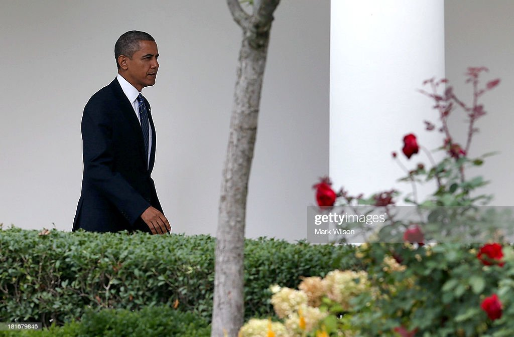 U.S. President <a gi-track='captionPersonalityLinkClicked' href=/galleries/search?phrase=Barack+Obama&family=editorial&specificpeople=203260 ng-click='$event.stopPropagation()'>Barack Obama</a> walks to Marine One before departing the White House, September 23, 2013 in Washington, DC. President Obama is traveling to New York to speak at the United Nations General Assembly.