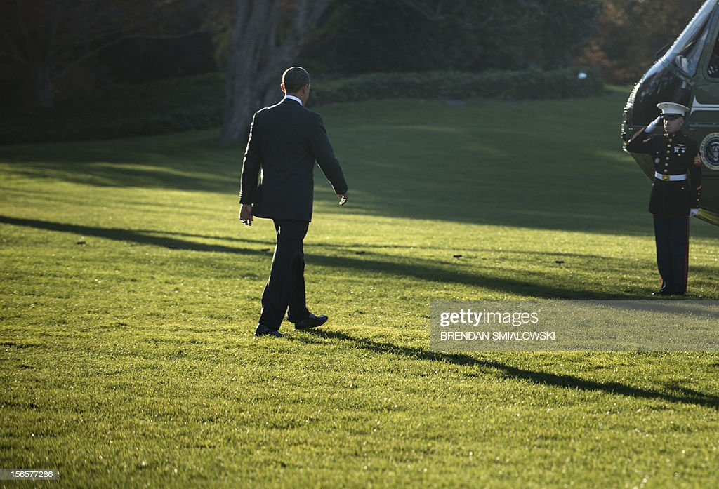 US President Barack Obama walks to Marine One on the South Lawn of the White House on November 17, 2012 in Washington
