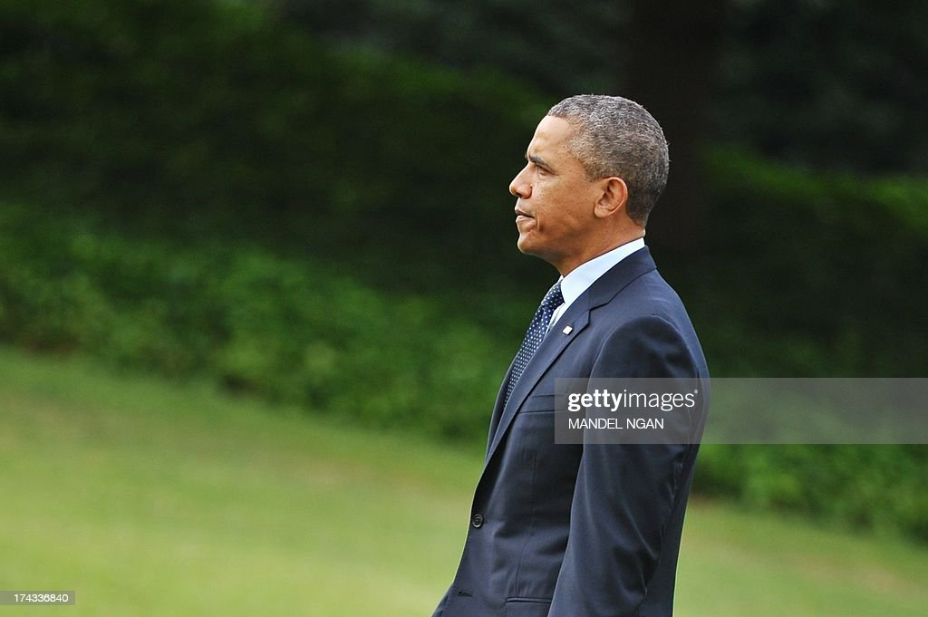 US President Barack Obama walks to Marine One on the South Lawn of the White House on July 24, 2013 in Washington, DC. Obama was headed to Galesburg, Illinois and Warrensburg, Missouri to speak on the economy. AFP PHOTO/Mandel NGAN