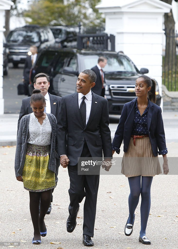 President <a gi-track='captionPersonalityLinkClicked' href=/galleries/search?phrase=Barack+Obama&family=editorial&specificpeople=203260 ng-click='$event.stopPropagation()'>Barack Obama</a> walks to St. John's Episcopal Church with his daughters Sasha (L) and Malia on October 28, 2012 in Washington, D.C.