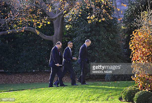 US President Barack Obama walks to the Oval Office of the White House with senior advisor David Axelrod and White House legislative affairs director...