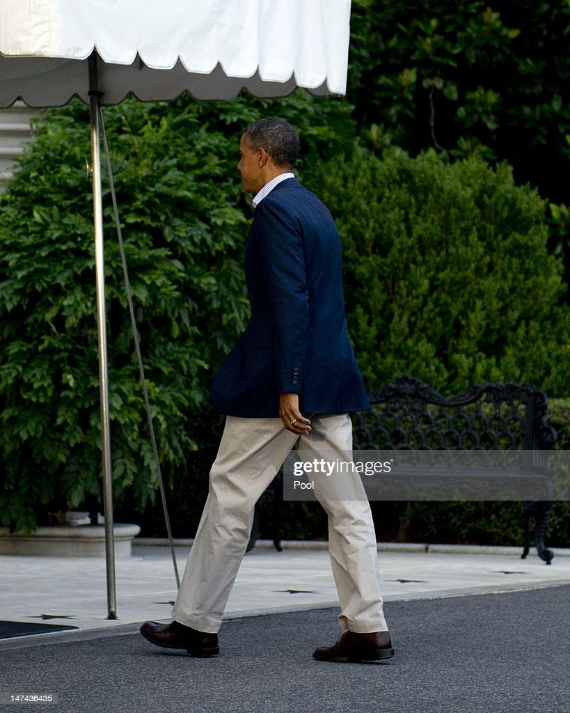 U.S. President Barack Obama walks to the White House after arriving aboard Marine One on the South Lawn June 29, 2012 in Washington, D.C. The president was returning from a trip to Colorado Springs, Colorado to view damage from the wildfires raging there and to thank emergency workers for their efforts.