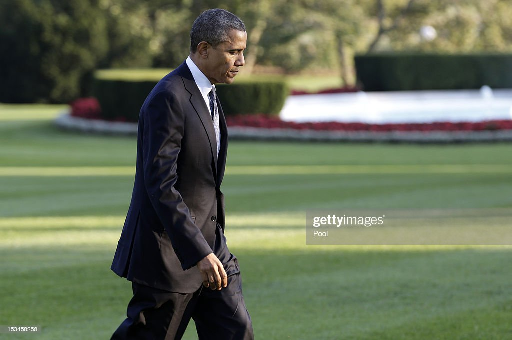 U.S. President <a gi-track='captionPersonalityLinkClicked' href=/galleries/search?phrase=Barack+Obama&family=editorial&specificpeople=203260 ng-click='$event.stopPropagation()'>Barack Obama</a> walks to the White House after arriving on the South Lawn aboard Marine One on October 5, 2012 in Washington, DC. Obama was returning from a campaign trip to Virginia and Ohio.