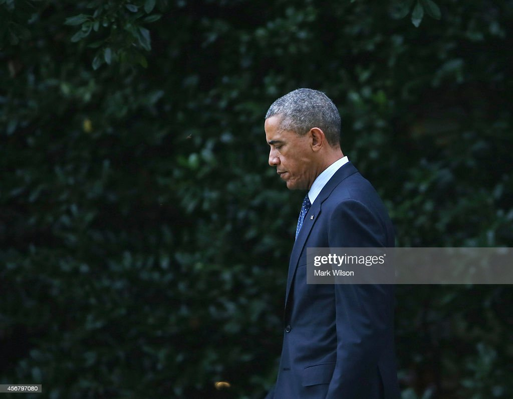 S President Barack Obama walks toward Marine One while departing the White House October 7 2014 in Washington DC Obama is traveling to New York to...
