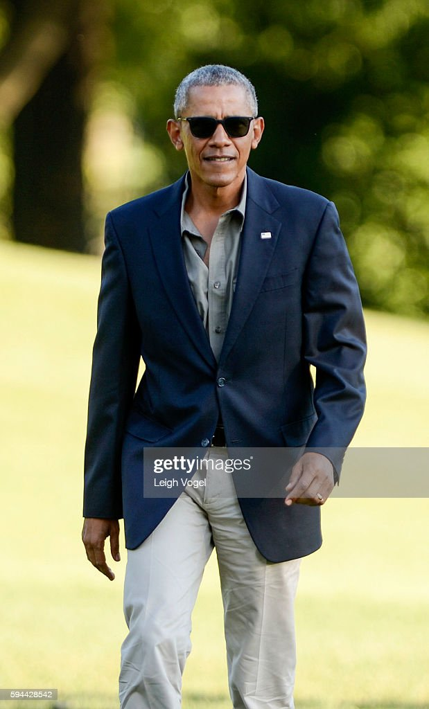 President Barack Obama walks toward the White House after exiting Marine One upon his arrival from Baton Rouge Louisiana on August 23 2016 in...