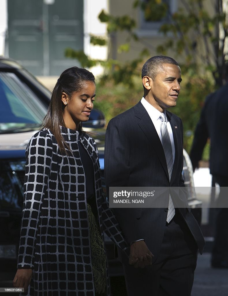 US President Barack Obama walks with daughter Malia after attending Sunday services at Saint John's Episcopal Church October 27, 2013 in Washington, DC. AFP PHOTO/Mandel NGAN