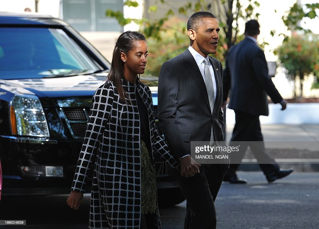 US President Barack Obama walks with daughter Malia back to the White House after attending Sunday services at Saint John's Episcopal Church October 27, 2013 in Washington, DC. AFP PHOTO/Mandel NGAN