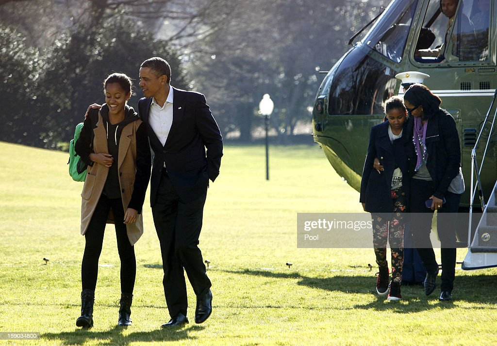 U.S. President <a gi-track='captionPersonalityLinkClicked' href=/galleries/search?phrase=Barack+Obama&family=editorial&specificpeople=203260 ng-click='$event.stopPropagation()'>Barack Obama</a> walks with daughter Malia, first lady <a gi-track='captionPersonalityLinkClicked' href=/galleries/search?phrase=Michelle+Obama&family=editorial&specificpeople=2528864 ng-click='$event.stopPropagation()'>Michelle Obama</a> walks with daughter Sasha from Marine One to the White House on January 6, 2013 in Washington, DC. Obama is expected to dominate Chuck Hagel, a Republican and former U.S. senator from Nebraska, to succeed Defense Secretary Leon Panetta.