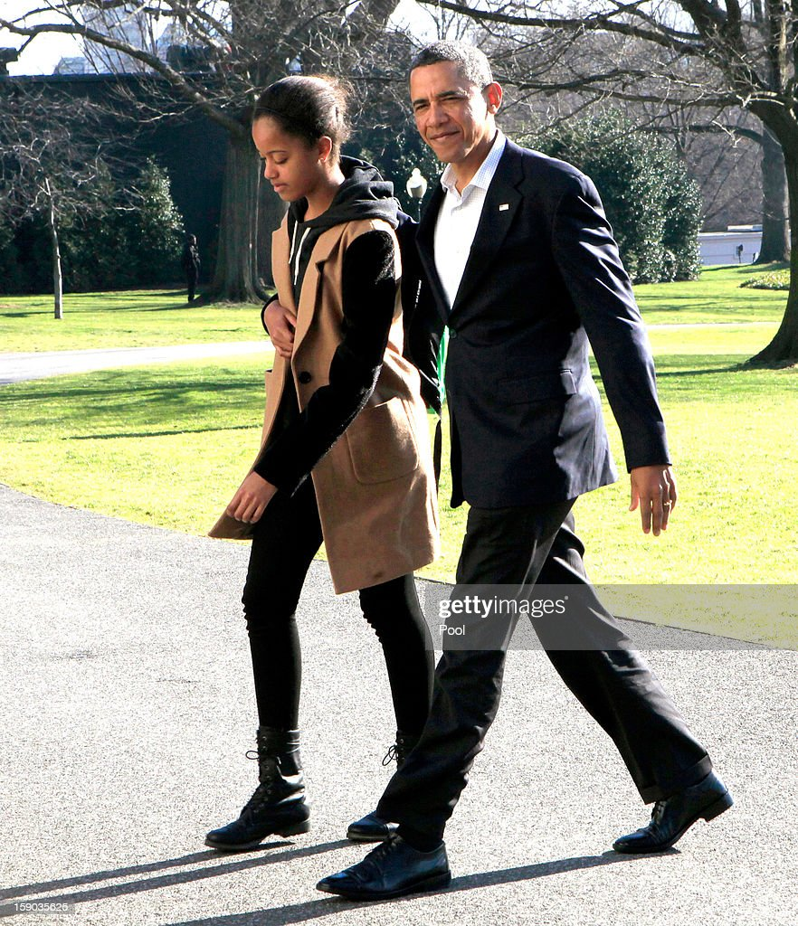 U.S. President <a gi-track='captionPersonalityLinkClicked' href=/galleries/search?phrase=Barack+Obama&family=editorial&specificpeople=203260 ng-click='$event.stopPropagation()'>Barack Obama</a> walks with daughter Malia from Marine One to the White House on January 6, 2013 in Washington, DC. Obama is expected to dominate Chuck Hagel, a Republican and former U.S. senator from Nebraska, to succeed Defense Secretary Leon Panetta.