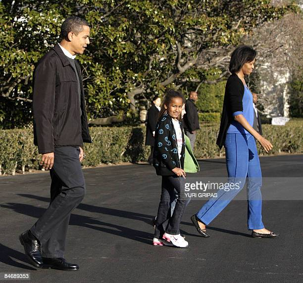 US President Barack Obama walks with first lady Michelle daughter Sasha and an unidentified friend walk on the South Lawn of the White House in...