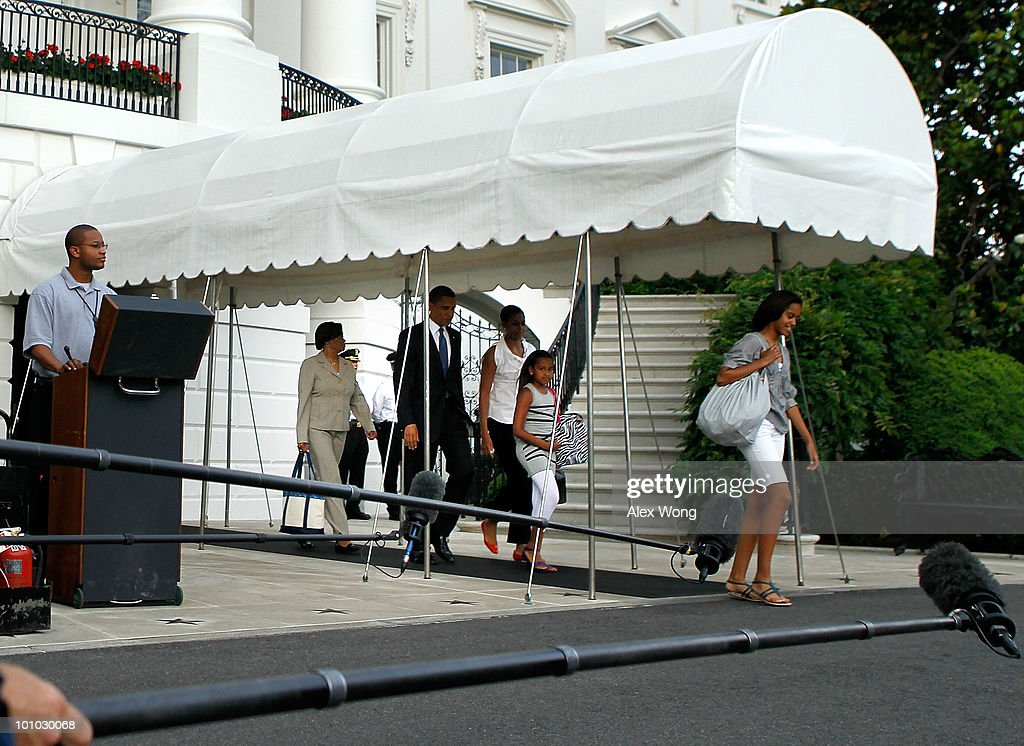 U.S. President Barack Obama (2L) walks with first lady Michelle Obama (C), daughters Malia Obama (R) and Sasha Obama (2R), and the first lady's mother Marian Robinson (L) toward Marine One prior to their departure for Chicago May 27, 2010 in Washington, DC. The Obamas were flying to Chicago for the Memorial Day weekend.
