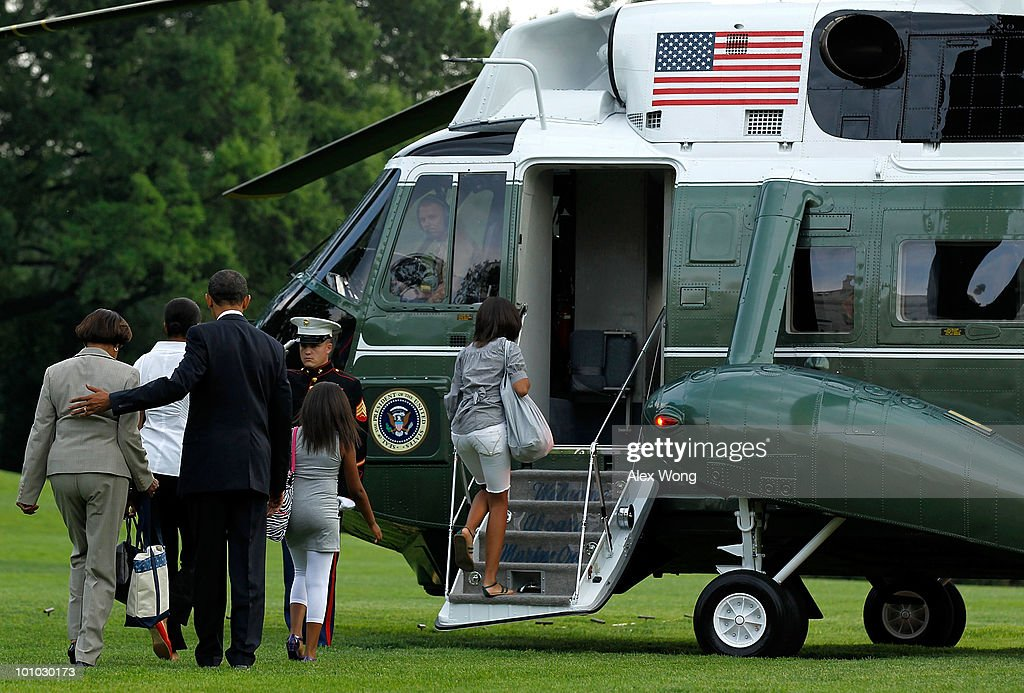 U.S. President Barack Obama (3L) walks with first lady Michelle Obama (2L), daughters Malia Obama (R) and Sasha Obama (2R), and the first lady's mother Marian Robinson toward Marine One prior to their departure from the White House May 27, 2010 in Washington, DC. The Obamas were flying to Chicago for the Memorial Day weekend.