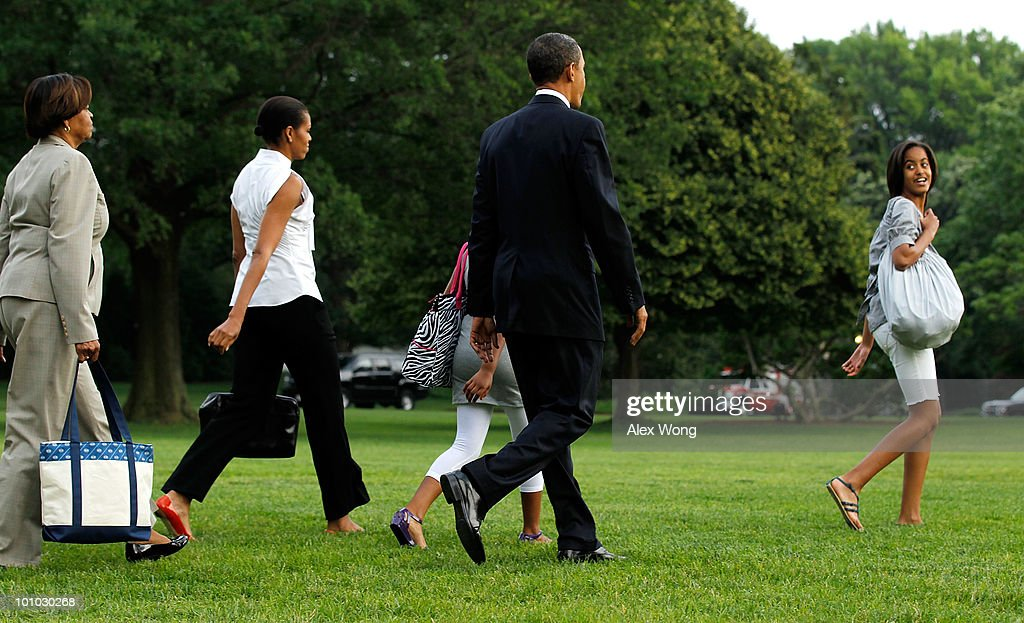 U.S. President Barack Obama (2R) walks with first lady Michelle Obama (2L), daughters Malia Obama (R) and Sasha Obama (C), and the first lady's mother Marian Robinson on the South Lawn prior to their departure from the White House May 27, 2010 in Washington, DC. The Obamas were flying to Chicago for the Memorial Day weekend.