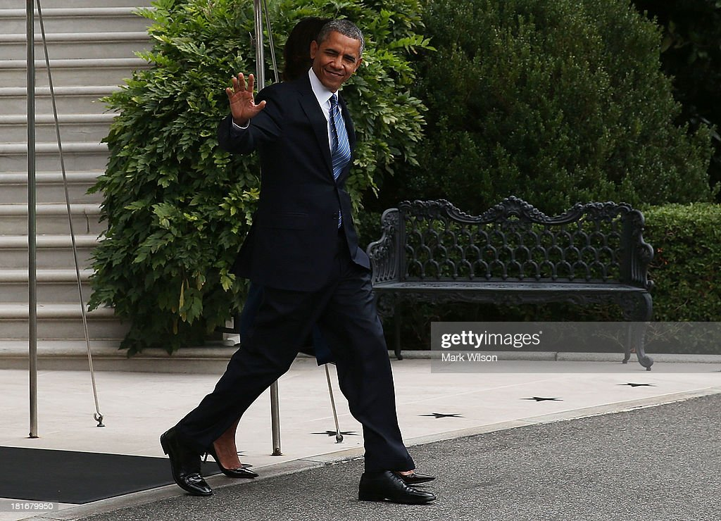 U.S. President <a gi-track='captionPersonalityLinkClicked' href=/galleries/search?phrase=Barack+Obama&family=editorial&specificpeople=203260 ng-click='$event.stopPropagation()'>Barack Obama</a> walks with first lady Michelle Obama (obscured) toward Marine One before departing the White House, September 23, 2013 in Washington, DC. President Obama is traveling to New York to speak at the United Nations General Assembly.