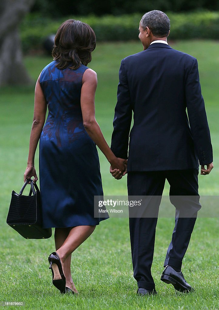 U.S. President <a gi-track='captionPersonalityLinkClicked' href=/galleries/search?phrase=Barack+Obama&family=editorial&specificpeople=203260 ng-click='$event.stopPropagation()'>Barack Obama</a> walks with first lady <a gi-track='captionPersonalityLinkClicked' href=/galleries/search?phrase=Michelle+Obama&family=editorial&specificpeople=2528864 ng-click='$event.stopPropagation()'>Michelle Obama</a> toward Marine One before departing the White House, September 23, 2013 in Washington, DC. President Obama is traveling to New York to speak at the United Nations General Assembly.