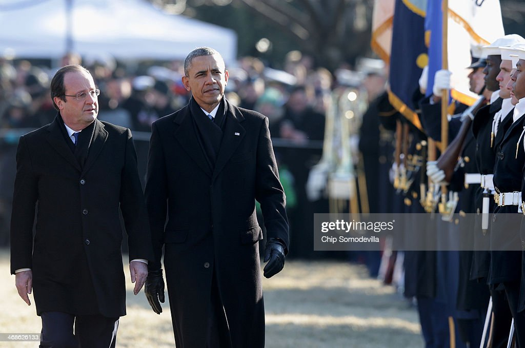 U.S. President <a gi-track='captionPersonalityLinkClicked' href=/galleries/search?phrase=Barack+Obama&family=editorial&specificpeople=203260 ng-click='$event.stopPropagation()'>Barack Obama</a> (R) walks with French President Francois Hollande during a welcoming ceremony on the South Lawn at the White House on February 11, 2014 in Washington, DC. Hollande who arrived yesterday for a three day state visit, visited Thomas Jefferson's Monticello estate and will be the guest of honor for a state dinner tonight.