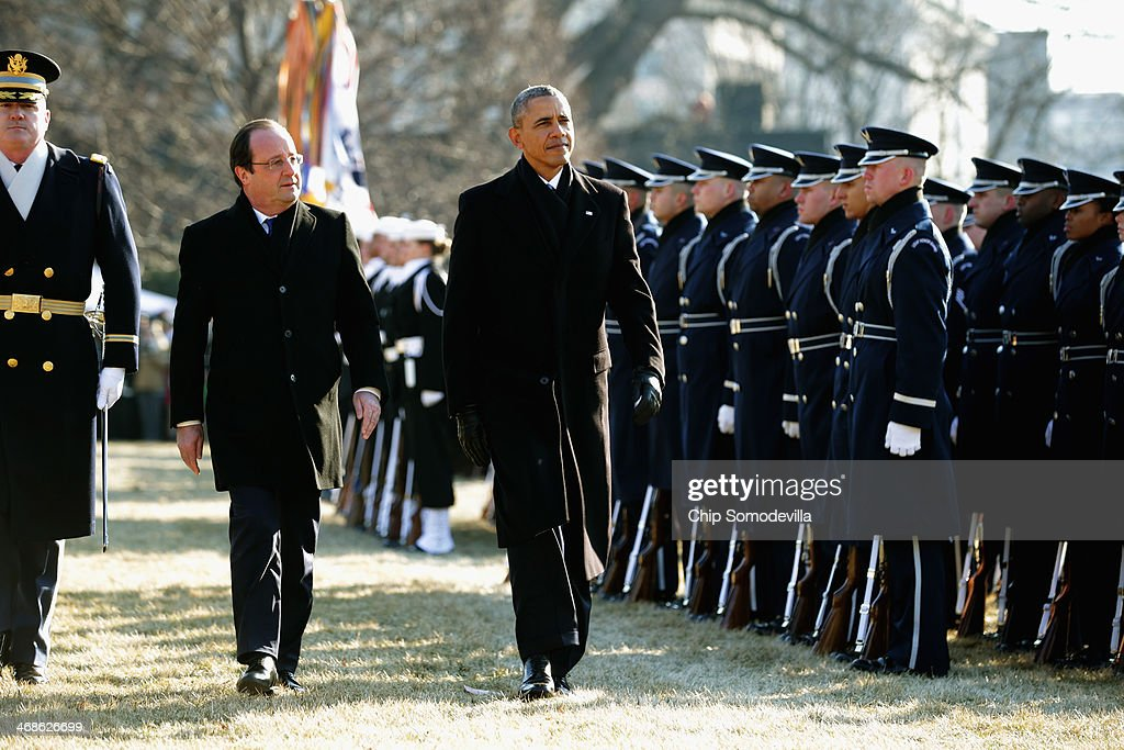 U.S. President <a gi-track='captionPersonalityLinkClicked' href=/galleries/search?phrase=Barack+Obama&family=editorial&specificpeople=203260 ng-click='$event.stopPropagation()'>Barack Obama</a> (R) walks with French President Francois Hollande for a military review during a welcoming ceremony on the South Lawn at the White House on February 11, 2014 in Washington, DC. Hollande who arrived yesterday for a three day state visit, visited Thomas Jefferson's Monticello estate and will be the guest of honor for a state dinner tonight.