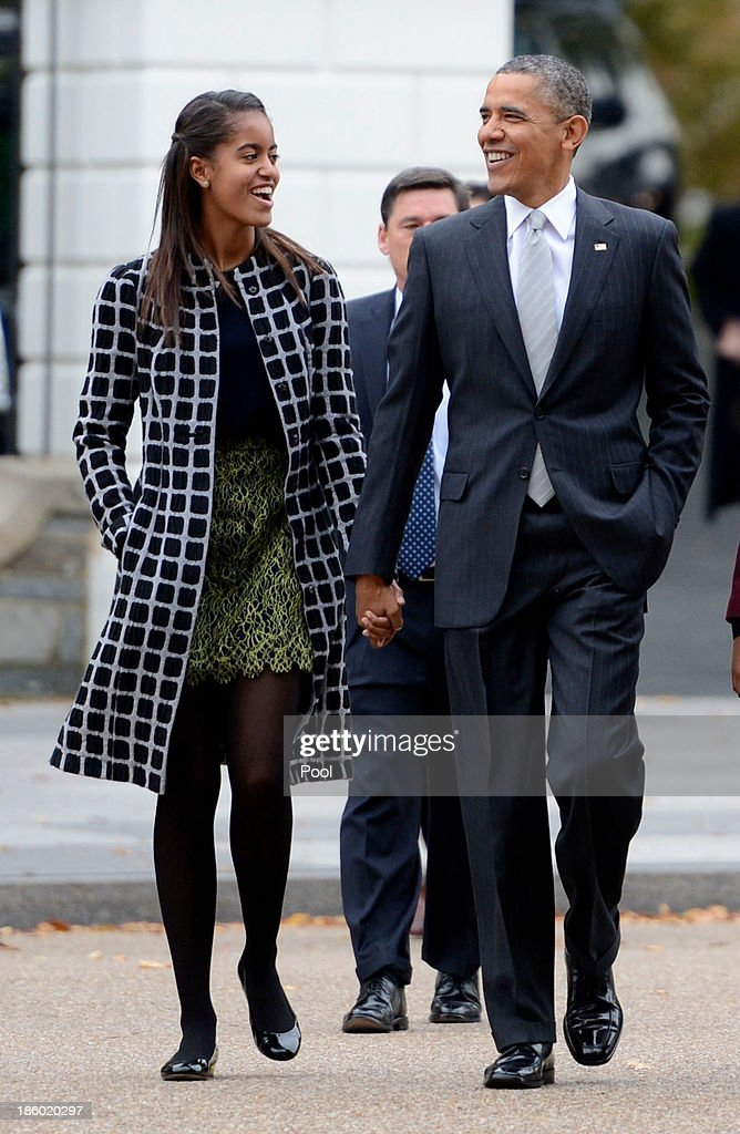 U.S. President <a gi-track='captionPersonalityLinkClicked' href=/galleries/search?phrase=Barack+Obama&family=editorial&specificpeople=203260 ng-click='$event.stopPropagation()'>Barack Obama</a> walks with his daughter <a gi-track='captionPersonalityLinkClicked' href=/galleries/search?phrase=Malia+Obama&family=editorial&specificpeople=2631620 ng-click='$event.stopPropagation()'>Malia Obama</a> (L) across Lafayette Park to St John's Church to attend service October 27, 2013 in Washington, DC. Obama is scheduled to travel to Boston this week.
