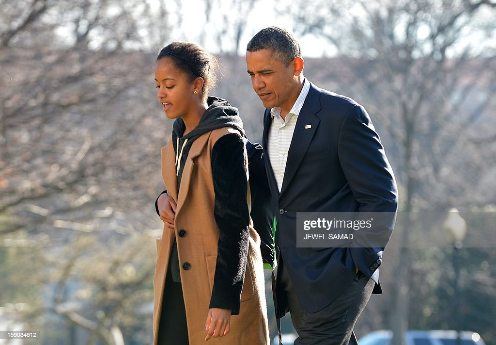 US President Barack Obama walks with his daughter Malia upon their return at the White House in Washington, DC, on January 6, 2013. Obama and his family returned in Washington, DC, from Hawaii where they had spent a Christmas vacation. AFP PHOTO/Jewel Samad
