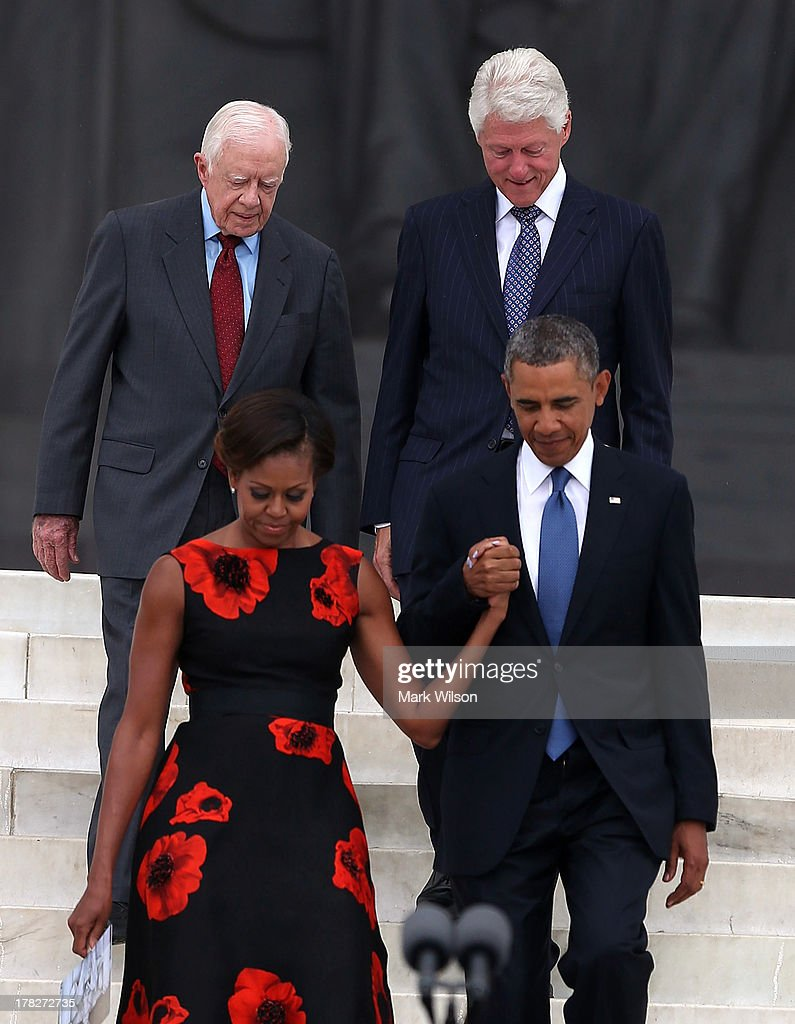 President Barack Obama (R) walks with his wife Michelle Obama (2nd-L) and former Presidents Jimmy Carter (L) and Bill Clinton during the ceremony to commemorate the 50th anniversary of the March on Washington for Jobs and Freedom August 28, 2013 in Washington, DC. It was 50 years ago today that Martin Luther King, Jr. delivered his 'I Have A Dream Speech' on the steps of the Lincoln Memorial.