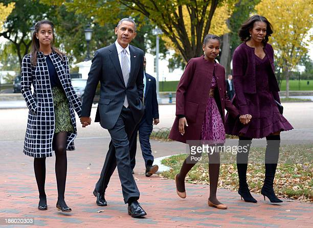 S President Barack Obama walks with his wife Michelle Obama and two daughters Malia Obama and Sasha Obama through Lafayette Park to St John's Church...