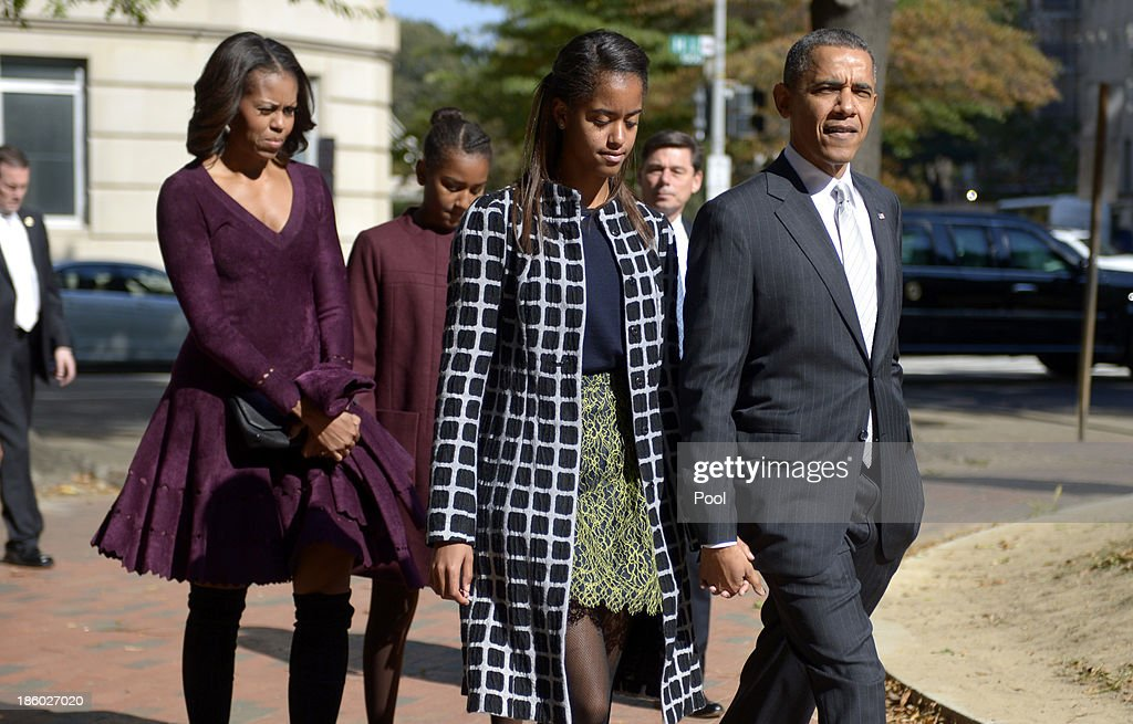 U.S. President <a gi-track='captionPersonalityLinkClicked' href=/galleries/search?phrase=Barack+Obama&family=editorial&specificpeople=203260 ng-click='$event.stopPropagation()'>Barack Obama</a> walks with his wife <a gi-track='captionPersonalityLinkClicked' href=/galleries/search?phrase=Michelle+Obama&family=editorial&specificpeople=2528864 ng-click='$event.stopPropagation()'>Michelle Obama</a> (L) and two daughters <a gi-track='captionPersonalityLinkClicked' href=/galleries/search?phrase=Malia+Obama&family=editorial&specificpeople=2631620 ng-click='$event.stopPropagation()'>Malia Obama</a> (2R) and <a gi-track='captionPersonalityLinkClicked' href=/galleries/search?phrase=Sasha+Obama&family=editorial&specificpeople=2631619 ng-click='$event.stopPropagation()'>Sasha Obama</a> (2L) from St. John's Church to the White House after service October 27, 2013 in Washington, DC. Obama is scheduled to travel to Boston this week.