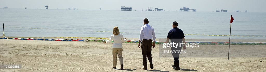 US President Barack Obama (C) walks with Incident Commander Admiral Thad Allen (R) and LaFourche Parish President Charlotte Randolf (L) at Port Fourchon Beach, Louisiana, on May 28, 2010 before a briefing on the federal government's response to the Gulf Coast oil spill. Obama stepped up the battle against a massive slick lapping the stricken Gulf Coast, vowing never to abandon those caught in the worst US oil spill. Tripling the manpower already feverishly working to protect the southern US coastline, he pledged 'to continue to do whatever it takes to help Americans whose livelihoods have been upended by the spill.' AFP PHOTO/Jim WATSON