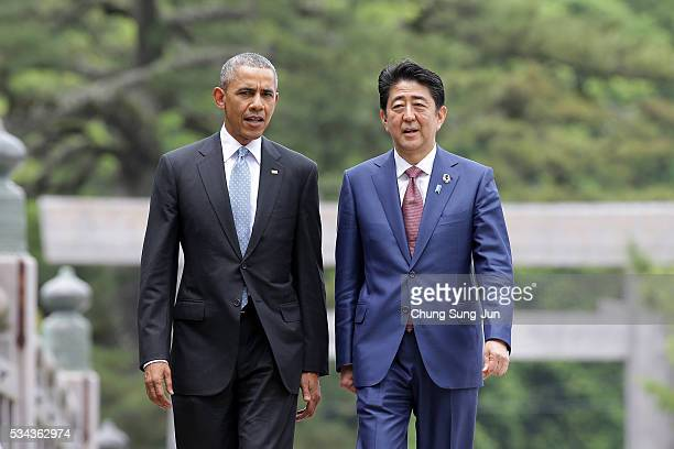 US President Barack Obama walks with Japanese Prime Minister Shinzo Abe on the Ujibashi bridge as they visit at the IseJingu Shrine on May 26 2016 in...