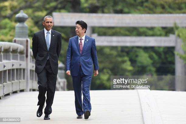 President Barack Obama walks with Japan's Prime Minister Shinzo Abe as they arrive at IseJingu Shrine in the city of Ise in Mie prefecture on May 26...