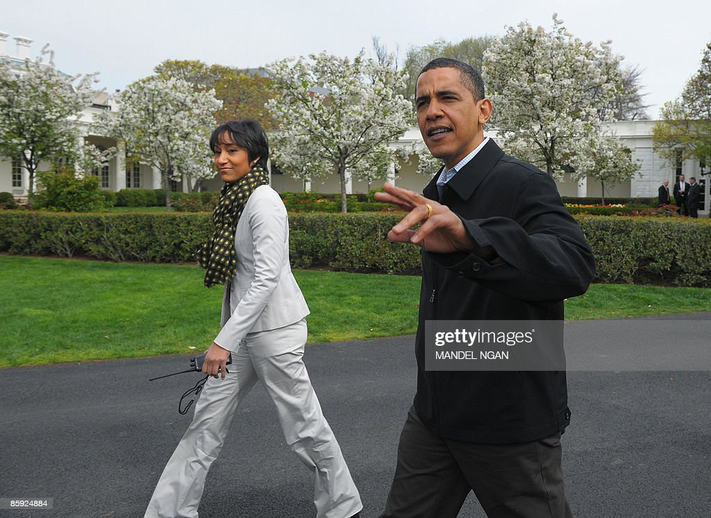 US President Barack Obama walks with White House Social Secretary Desiree Rogers during the annual East Egg roll at the White House April 13 2009 in...
