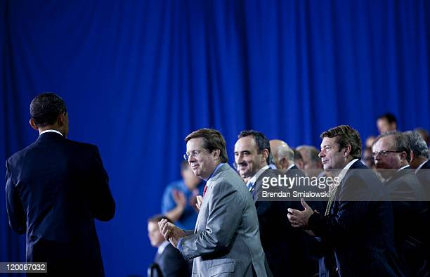 US President Barack Obama watches as Jim Lentz President and COO of Toyota Motor Sales USA Josef Kerscher President of BMW Manufacturing Co Andrew...