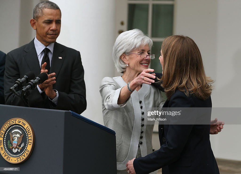 U.S. President Barack Obama (L) watches as outgoing Health and Human Services Secretary Kathleen Sebelius (C) hugs Director of the White House Office of Management and Budget Sylvia Mathews Burwell (R) during an event in the Rose Garden at the White House, on April 11, 2014 in Washington, DC. President Obama announced his nomination of Burwell to succeed Sebelius as Secretary.