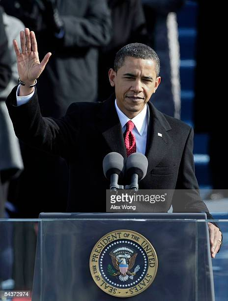 President Barack Obama waves after giving his inaugural address during his inauguration as the 44th President of the United States of America on the...