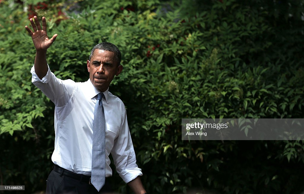 U.S. President <a gi-track='captionPersonalityLinkClicked' href=/galleries/search?phrase=Barack+Obama&family=editorial&specificpeople=203260 ng-click='$event.stopPropagation()'>Barack Obama</a> waves after he unveiled his climate plan June 25, 2013 at Georgetown University in Washington, DC. President Obama laid out his plan to diminish carbon pollution and prepare the country for the impacts of climate change.