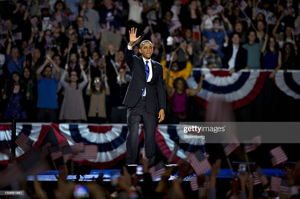 U.S. President Barack Obama waves after making an acceptance speech during an election night rally in Chicago, Illinois, U.S., in the early morning on Wednesday, Nov. 7, 2012. Obama, the post-partisan candidate of hope who became the first black U.S. president, won re-election today by overcoming four years of economic discontent with a mix of political populism and electoral math. Photographer: Daniel Acker/Bloomberg via Getty Images